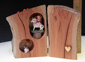 Unique enchanted wood fairy tree house in real log, handmade in Aussie, features unicorn